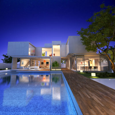 27339997 - external view of a contemporary house with pool at dusk